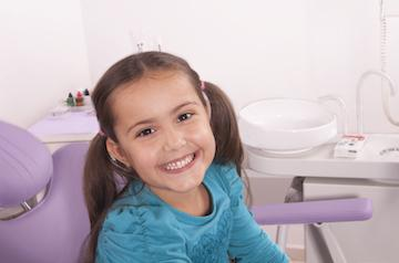 Young girl smiling in treatment chair at childrens dentist in Lexington KY