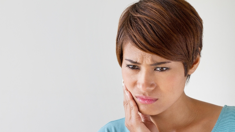 Woman With Tooth Pain | Emergency Dentist in Lexington