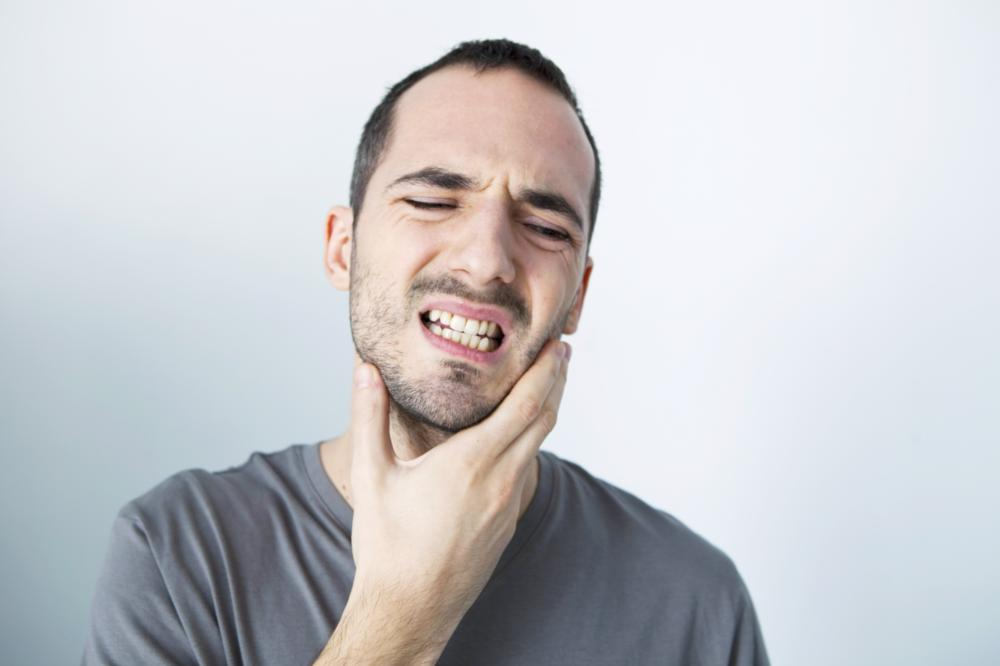 Man with Tooth Pain | Garden Springs Dental
