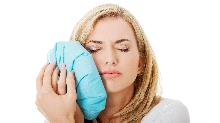 Woman with Tooth Pain | Tooth Extractions in Lexington